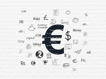 Money concept: Euro on wall background. Money concept: Painted black Euro icon on White Brick wall background with  Hand Drawn Finance Icons Stock Photo