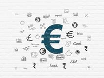 Money concept: Euro on wall background. Money concept: Painted blue Euro icon on White Brick wall background with  Hand Drawn Finance Icons Royalty Free Stock Photography
