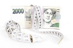 Money concept of expensive bill with measurement tape. Banknotes of czech crowns money concept of expensive bill with measurement tape Royalty Free Stock Photography