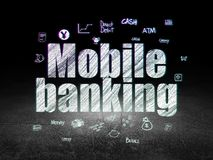 Money concept: Mobile Banking in grunge dark room. Money concept: Glowing text Mobile Banking,  Hand Drawn Finance Icons in grunge dark room with Dirty Floor Royalty Free Stock Photo