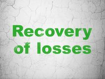 Money concept: Recovery Of losses on wall background. Money concept: Green Recovery Of losses on textured concrete wall background Stock Photos