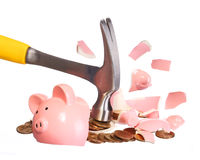 Money Concept. Hammer breaking Piggy Bank Stock Image