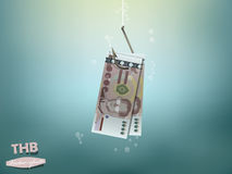 Money concept illustration, thai baht money paper on fish hook Royalty Free Stock Photo