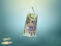 Money concept illustration,vietnam dong money paper on fish hook Royalty Free Stock Image