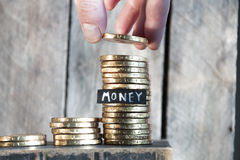 Money concept, a man rising coins Royalty Free Stock Photography