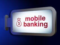 Money concept: Mobile Banking and Money Bag on billboard background. Money concept: Mobile Banking and Money Bag on advertising billboard background, 3D Stock Photos