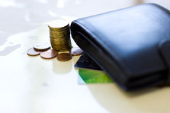 Money concept: сoins, purse, credit cards. Royalty Free Stock Images
