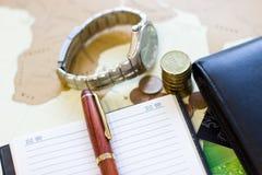 Money concept: сoins, purse, credit cards,wristwatch, pen, note Stock Images