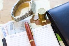 Money concept: сoins, purse, credit cards,wristwatch, pen, note Stock Photos
