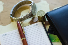 Money concept: сoins, purse, credit cards,wristwatch, pen, note Royalty Free Stock Photos