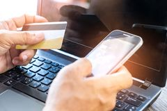 Money concept,Online payment by credit card,Using smart phones o Stock Photography
