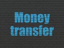 Money concept: Money Transfer on wall background. Money concept: Painted blue text Money Transfer on Black Brick wall background Royalty Free Stock Photo