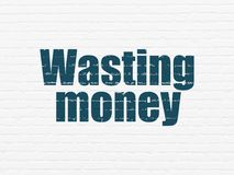 Money concept: Wasting Money on wall background Royalty Free Stock Photos