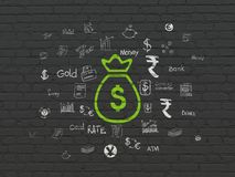 Money concept: Money Bag on wall background. Money concept: Painted green Money Bag icon on Black Brick wall background with  Hand Drawn Finance Icons Stock Photo