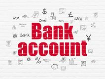 Money concept: Bank Account on wall background. Money concept: Painted red text Bank Account on White Brick wall background with  Hand Drawn Finance Icons Royalty Free Stock Photo
