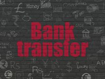 Money concept: Bank Transfer on wall background. Money concept: Painted red text Bank Transfer on Black Brick wall background with  Hand Drawn Finance Icons Stock Photos
