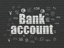 Money concept: Bank Account on wall background. Money concept: Painted white text Bank Account on Black Brick wall background with  Hand Drawn Finance Icons Royalty Free Stock Images