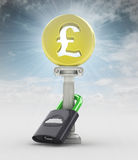 Money concept with pound coin in sky flare Stock Images