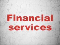Money concept: Financial Services on wall background. Money concept: Red Financial Services on textured concrete wall background Royalty Free Stock Images