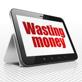 Money concept: Tablet Computer with Wasting Money on display Royalty Free Stock Photos