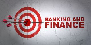 Money concept: target and Banking And Finance on wall background. Success money concept: arrows hitting the center of target, Red Banking And Finance on wall Stock Images