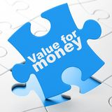 Money concept: Value For Money on puzzle background Royalty Free Stock Photos