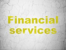 Money concept: Financial Services on wall background. Money concept: Yellow Financial Services on textured concrete wall background Stock Photography