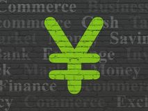 Money concept: Yen on wall background. Money concept: Painted green Yen icon on Black Brick wall background with  Tag Cloud Royalty Free Stock Images