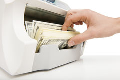 Money counting machine. Stock Photos