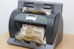 Money in the counting Machine Stock Photos
