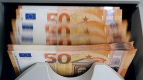 Money-counting machine with euros in it. 4K stock video
