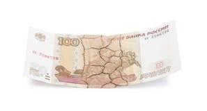 Money. Cracked ruble  on white background Stock Photos