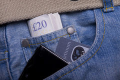 Money, credit card, smartphone in a pocket Stock Images