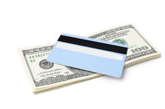 Money and credit card. A white background Royalty Free Stock Images
