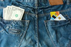 Money and credit cards in two back pocket Stock Photo