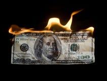 Money crisis. Burning 100 dollar bill / money crisis Stock Photos