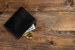 Money and Crypto-currency in the physical purse. The concept of virtual money in the wallet. On a wooden table. Money and Crypto-currency in the physical purse royalty free stock photography