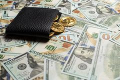 Money and Crypto-currency in the physical purse. The concept of virtual money in the wallet. On a dollar background. Currency banking, payment, success royalty free stock images