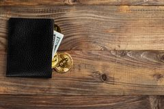 Money and Crypto-currency in the physical purse. The concept of virtual money in the wallet. On a wooden table. Money and Crypto-currency in the physical purse royalty free stock photos