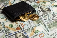 Money and Crypto-currency in the physical purse. The concept of virtual money in the wallet. On a dollar background. Copyspace stock photos