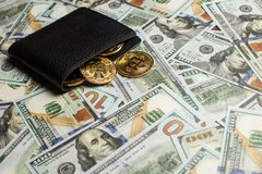Money and Crypto-currency in the physical purse. The concept of virtual money in the wallet. On a dollar background. Copyspace stock images