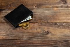 Money and Crypto-currency in the physical purse. The concept of virtual money in the wallet. On a wooden table. Banking, finance, success royalty free stock photos