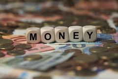 Money - cube with letters, money sector terms - sign with wooden cubes Stock Photos