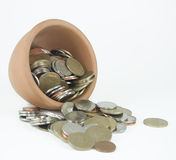 Money in a cup Stock Images
