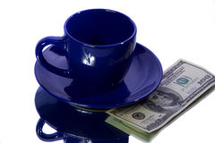 Money with cup Royalty Free Stock Photo