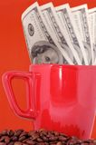 Money, cup and coffee grains Stock Images