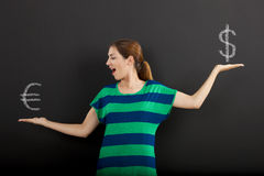 Money currency concept. Happy woman in front of a chalkboard ilustrating a concept about money currency Stock Image