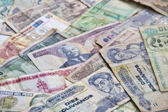 Money currency from several countries. Money banknotes from several Asian south american countries isolated stock photos