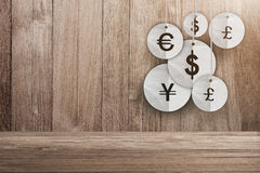 Money currency symbol hanging on wooden background Royalty Free Stock Photos