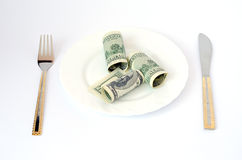 Money with cutlery Royalty Free Stock Image
